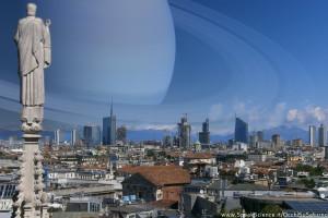 Una vista dei tetti di Milano, se Saturno prendesse il posto della Luna nel cielo. Una creazione SpeakScience per OcchiSuSaturno2015. Immagine originale.